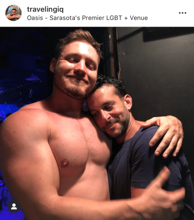 TravelingIQ at Oasis gay bar in Sarasota with go-go boy