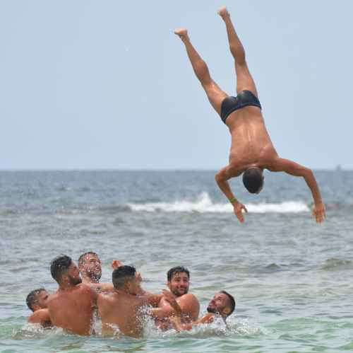 Hot guys playing on the beach